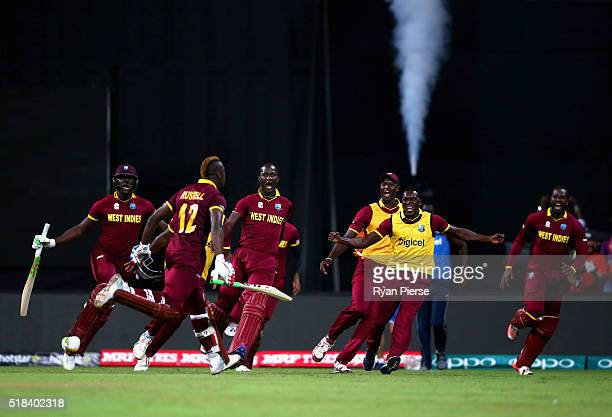 Andre Russell of the West Indies celebrates after hitting the winning runs during the ICC World Twenty20 India 2016 Semi Final match between West...