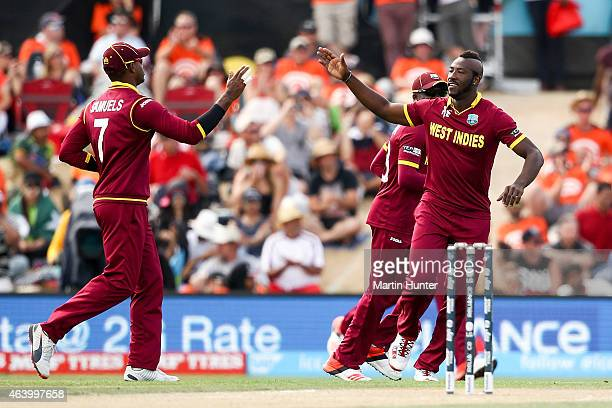 Andre Russell of the West Indies celebrates after taking a wicket during the 2015 ICC Cricket World Cup match between Pakistan and the West Indies at...