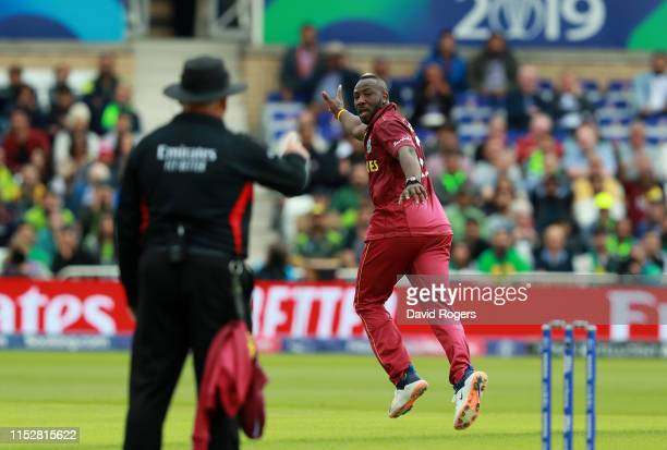 Andre Russell of the West Indies celebrates after taking the wicket of Haris Sohail during the Group Stage match of the ICC Cricket World Cup 2019...