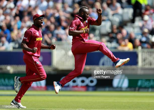 Andre Russell of the West Indies celebrates after taking the wicket of Usman Khawaja during the Group Stage match of the ICC Cricket World Cup 2019...