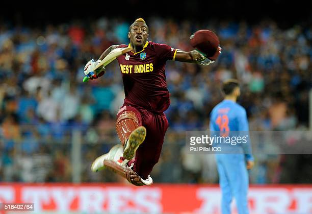 Andre Russell of the West Indies celebrates after winning the ICC World Twenty20 India 2016 Semi Final match between India and West Indies on March...