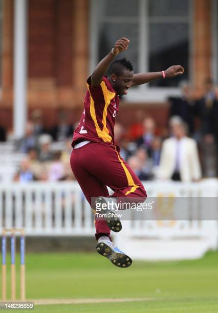 Andre Russell of the West Indies celebrates taking the wicket of Sam Robson of Middlesex during the tour match between Middlesex and West Indies at...