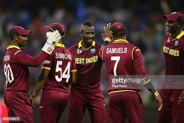 Andre Russell of the West Indies celebrates the wicket of Ravindra Jadeja of India during the 2015 ICC Cricket World Cup match between India and the...