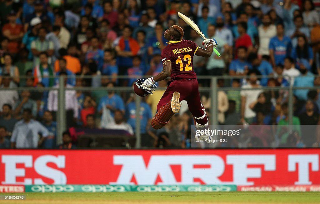 Andre Russell of the West Indies celebrates the winning runs during the ICC World Twenty20 India 2016 Semi-Final match between West Indies and India at Wankhede Stadium on March 31, 2016 in Mumbai, India.
