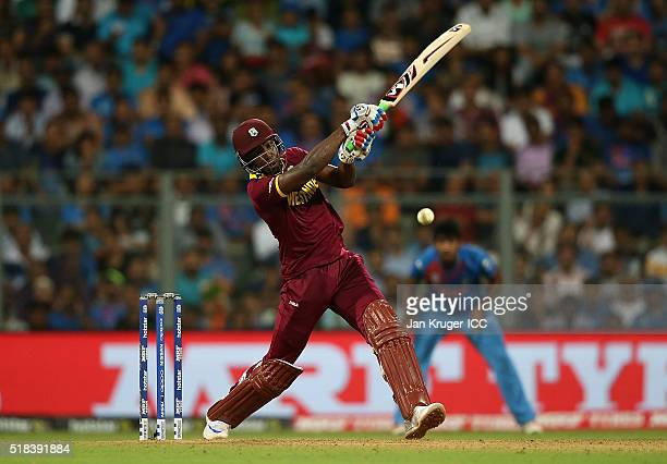 Andre Russell of the West Indies hits out during the ICC World Twenty20 India 2016 SemiFinal match between West Indies and India at Wankhede Stadium...