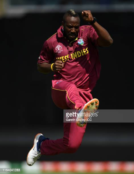 Andre Russell of West Indies celebrates after taking the wicket of Usman Khawaja of Australia during the Group Stage match of the ICC Cricket World...