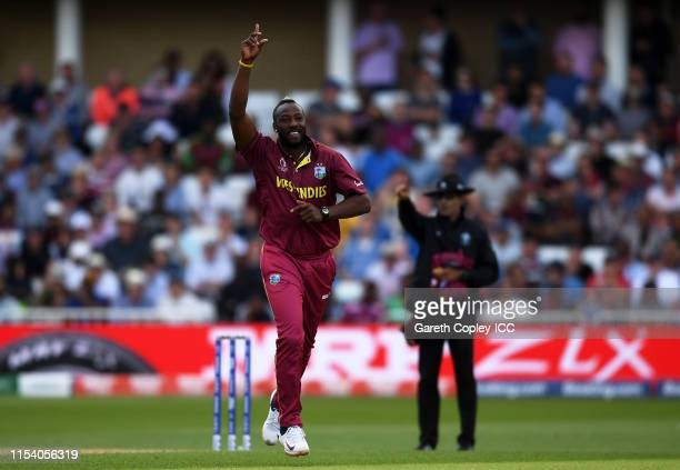 Andre Russell of West Indies celebrates after taking the wicket of Alex Carey of Australia during the Group Stage match of the ICC Cricket World Cup...
