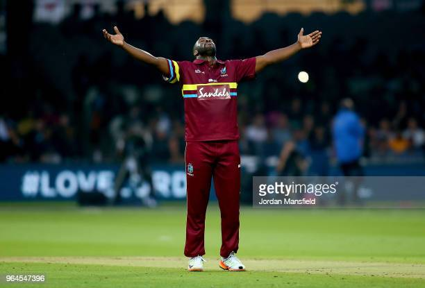 Andre Russell of West Indies celebrates dismisisng Sam Billings of ICC World XI during the T20 match between ICC World XI and West Indies at Lord's...