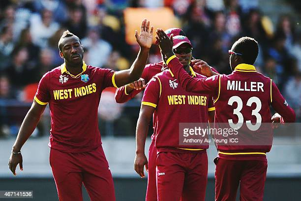 Andre Russell of West Indies celebrates getting the wicket of Corey Anderson of New Zealand during the 2015 ICC Cricket World Cup match between New...