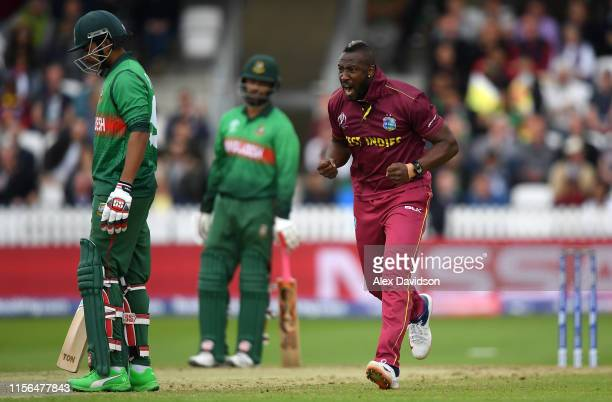 Andre Russell of West Indies celebrates taking the wicket of Soumya Sarkar of Bangladesh during the Group Stage match of the ICC Cricket World Cup...