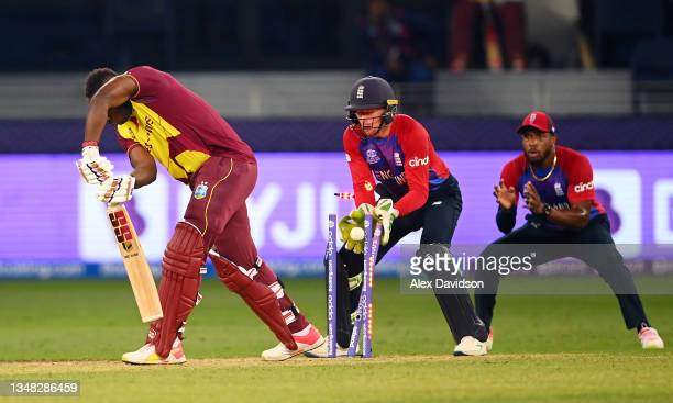 Andre Russell of West Indies is bowled by Adil Rashid of England during the ICC Men's T20 World Cup match between England and Windies at Dubai...
