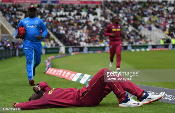 Andre Russell of West Indies lies on the floor after apeparing to pick up an injury during the Group Stage match of the ICC Cricket World Cup 2019...
