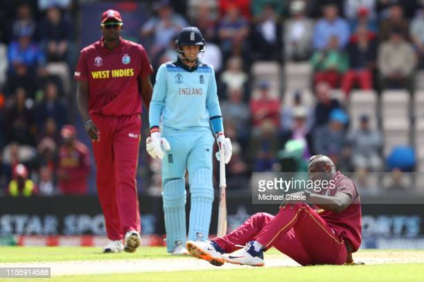 Andre Russell of West Indies lies on the wicket after injuring himself bowling during the Group Stage match of the ICC Cricket World Cup 2019 between...