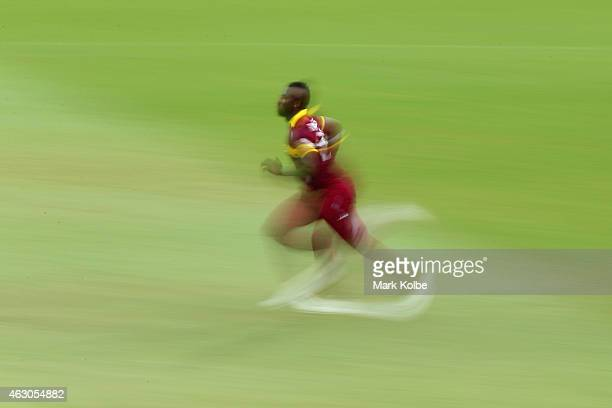 Andre Russell of West Indies runs in to bowl during the ICC Cricket World Cup warm up match between England and the West Indies at Sydney Cricket...