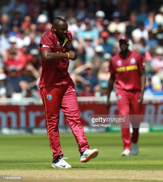 Andre Russell, the West Indies bowler, leaves the field after a picking up a leg injury during the Group Stage match of the ICC Cricket World Cup...