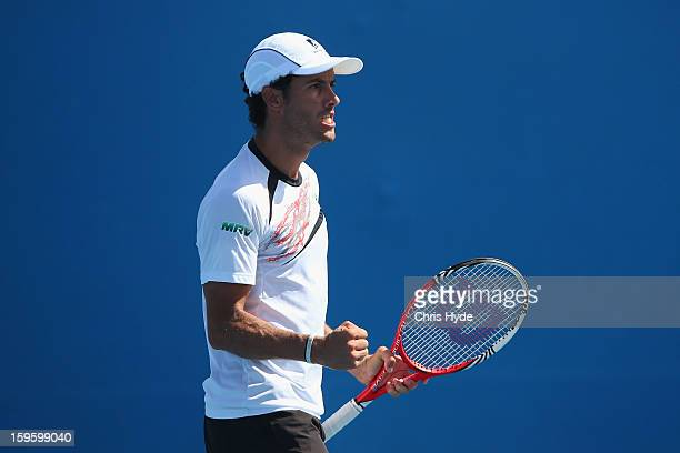 Andre Sa of Brazil celebrates a point in his first round doubles match with Jonathan Marray of Great Britain against Lukas Lacko and Igor Zelenay of...