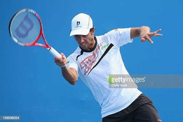 Andre Sa of Brazil plays a forehand in his first round doubles match with Jonathan Marray of Great Britain against Lukas Lacko and Igor Zelenay of...