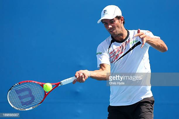 Andre Sa of Brazil plays a forehand in his men's first round doubles match with Jonathan Murray of Great Britain against Lukas Lacko of Slovakia and...