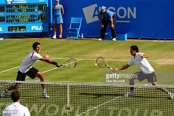 Andre Sa of Brazil plays a forehand playing with Marcelo Melo of Brazil during the men's doubles semi final match against Jeff Coetzee of South...