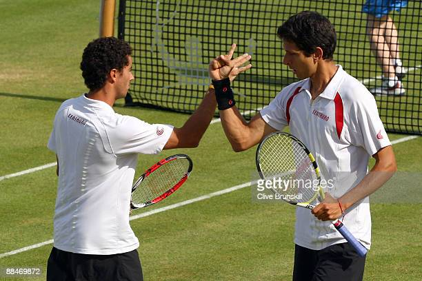 Andre Sa of Brazil talks with Marcelo Melo of Brazil during the men's doubles semi final match against Jeff Coetzee of South Africa and Jordan Kerr...