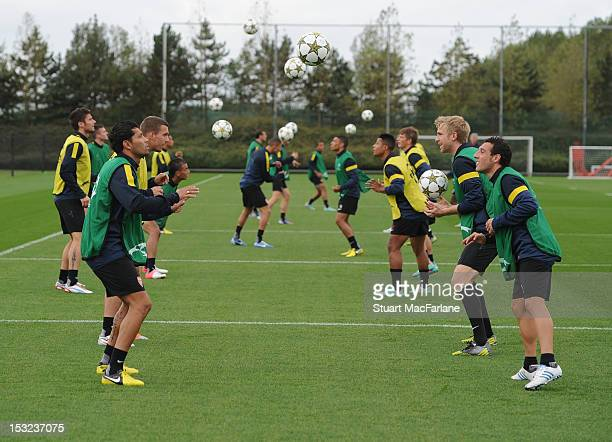 Andre Santos and Santi Cazorla of Arsenal during a training session at London Colney on October 2, 2012 in St Albans, England.