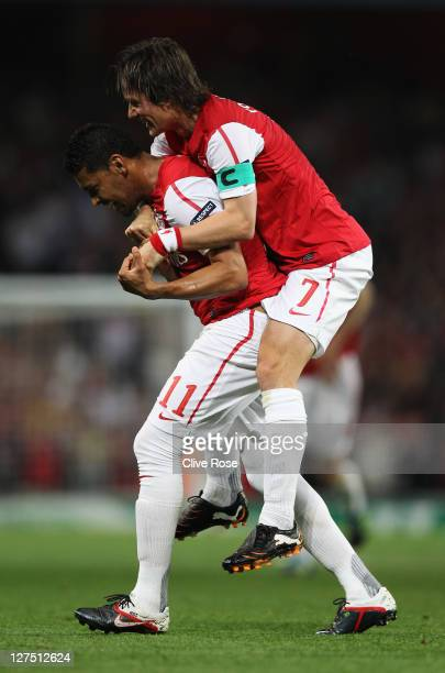 Andre Santos of Arsenal celebrates with Tomas Rosickyas he scores their second goal during the UEFA Champions League Group F match between Arsenal...