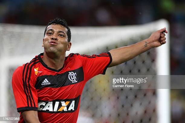 Andre Santos of Flamengo celebrates a scored goal during a match between Flamengo and Fluminense as part of the Brazilian Championship Serie A 2013...
