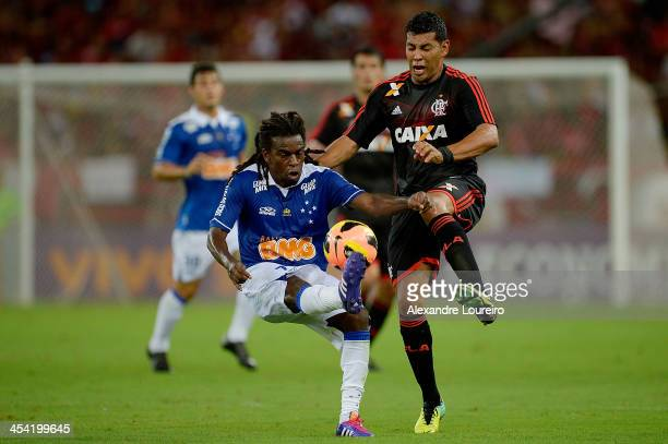 Andre Santos of Flamengo fights for the ball with Tinga of Cruzeiro during the match between Flamengo and Cruzeiro for the Brazilian Series A 2013 at...