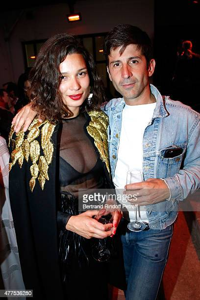 Andre Saraiva and his companion attend the 'Alaia' Azzedine Alaia Perfum Launch Party on May 21 2015 in Paris France