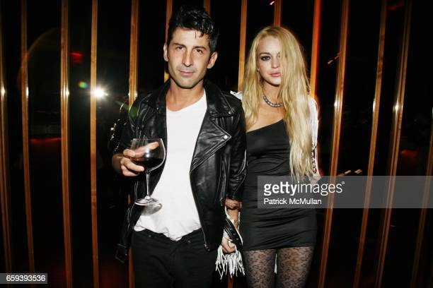 Andre Saraiva and Lindsay Lohan attend PURPLE Magazine Fashion Week Party at The Boom Boom Room at The Standard on September 13 2009 in New York City