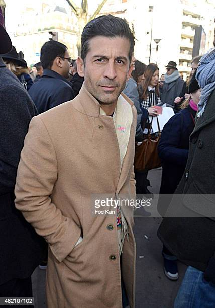 Andre Saraiva attends the Dior Homme Menswear Fall/Winter 20152016 show as part of Paris Fashion Week on January 24 2015 in Paris France