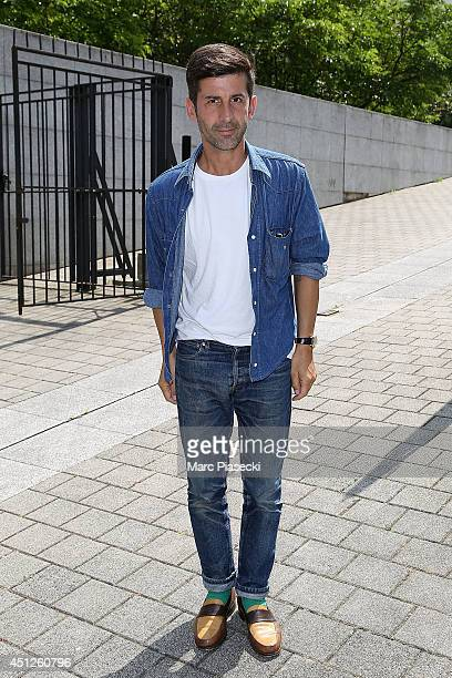 Andre Saraiva leaves the 'Louis Vuitton' Menswear Spring/Summer 2015 fashion show on June 26 2014 in Paris France