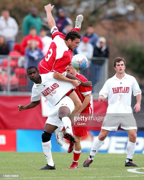 Andre Schmid of St john's keeps a firm grip on Maurice Edu of Maryland in a game where Maryland beat St John's 31 in a third round NCAA championship...
