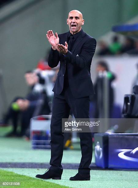 Andre Schubert head coach of Borussia Moenchengladbach gives his team instructions during the UEFA Champions League Group C match between VfL...