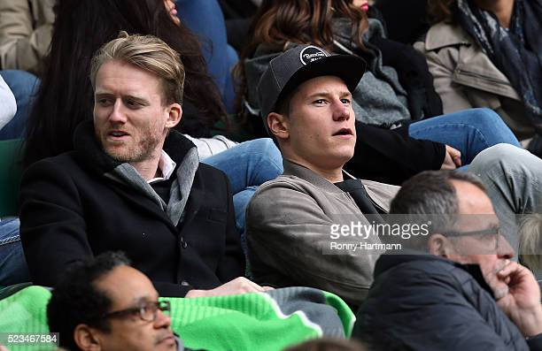 Andre Schuerrle and Julian Draxler of Wolfsburg at the stands during the Bundesliga match between VfL Wolfsburg and FC Augsburg at Volkswagen Arena...