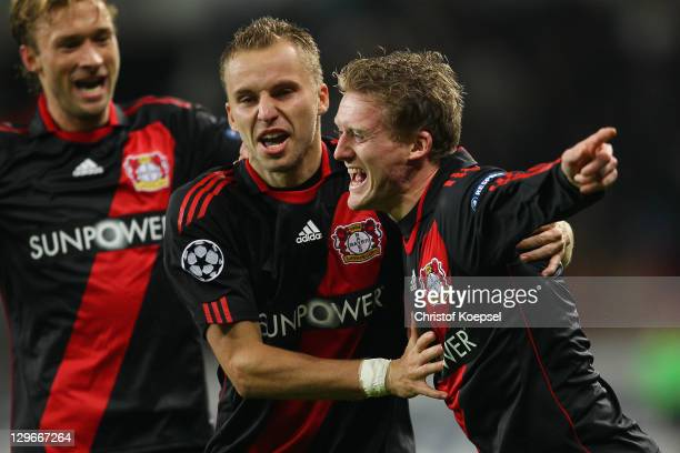 Andre Schuerrle celebrates the first goal with Michal Kaldec and Simon Rolfes of Leverkusen during the UEFA Champions League group E match between...
