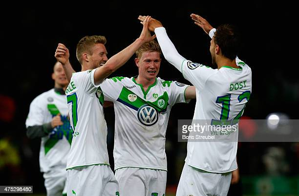 Andre Schuerrle Kevin De Bruyne and Bas Dost of Wolfsburg celebrate after winning the DFB Cup Final match between Borussia Dortmund and VfL Wolfsburg...