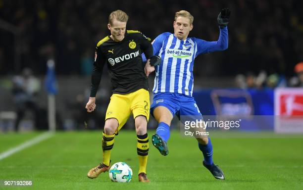 Andre Schuerrle of Borussia Dortmund and Arne Maier of Hertha BSC during the Bundesliga match between Hertha BSC and Borussia Dortmund at the...