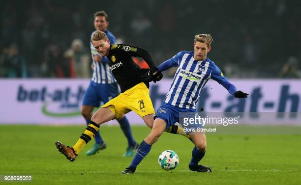 Andre Schuerrle of Borussia Dortmund battles for the ball with Arne Maier of Hertha BSC during the Bundesliga match between Hertha BSC and Borussia...