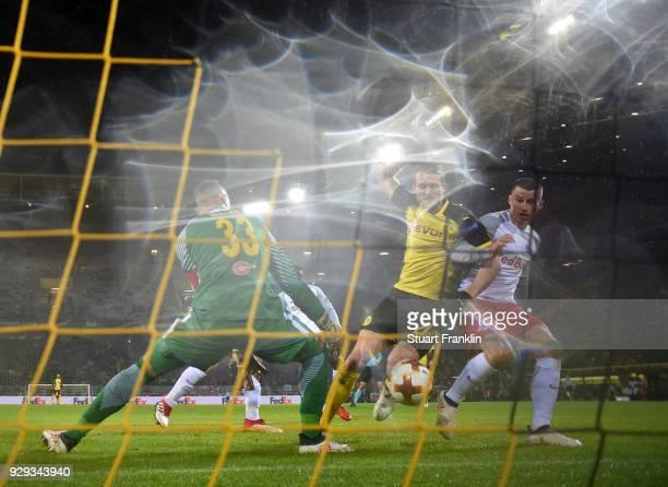 Andre Schuerrle of Borussia Dortmund beats goalkeeper Alexander Walke of Red Bull Salzburg as he scores their first goal during the UEFA Europa...