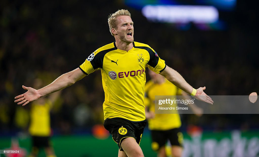Andre Schuerrle of Borussia Dortmund celebrates after scoring the goal to the 2:2 during the UEFA Champions League: First Qualifying Round 1st Leg match between Borussia Dortmund and Real Madrid CF at Signal Iduna Park on September 27, 2016 in Dortmund, Germany.