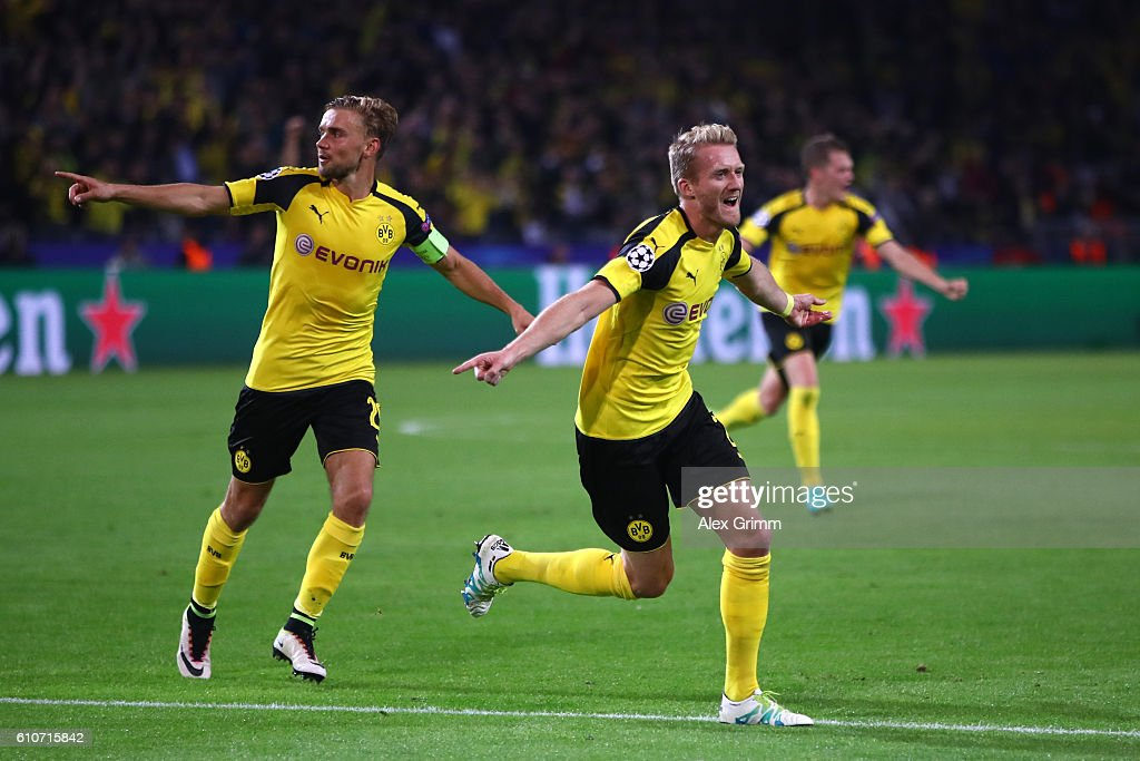Andre Schuerrle of Borussia Dortmund (R) celebrates as he scores their second goal during the UEFA Champions League Group F match between Borussia Dortmund and Real Madrid CF at Signal Iduna Park on September 27, 2016 in Dortmund, North Rhine-Westphalia.