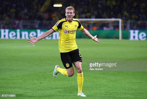 Andre Schuerrle of Borussia Dortmund celebrates as he scores their second goal during the UEFA Champions League Group F match between Borussia...