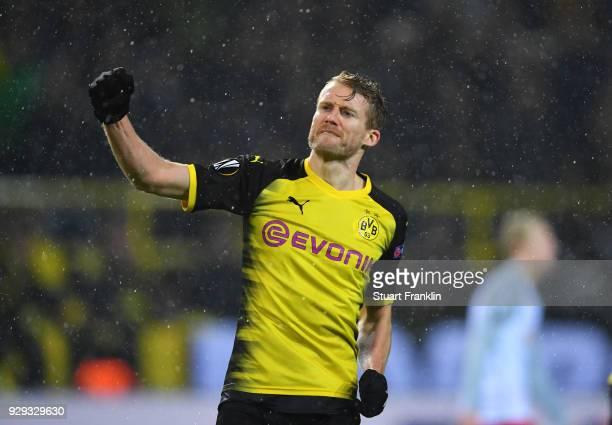 Andre Schuerrle of Borussia Dortmund celebrates as he scores their first goal during the UEFA Europa League Round of 16 match between Borussia...