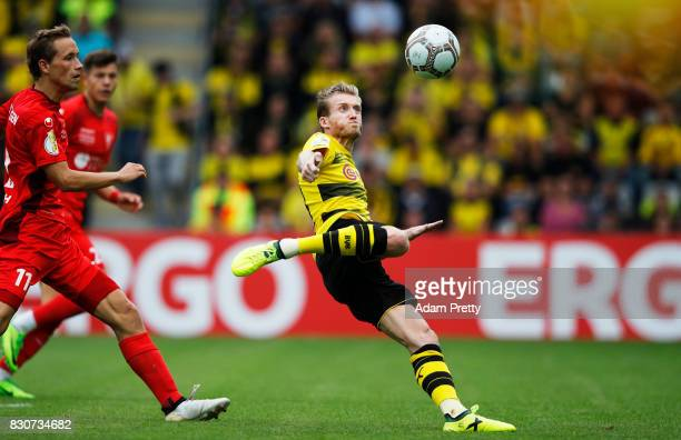 Andre Schuerrle of Borussia Dortmund takes a shot during the DFB Cup match between 1 FC RielasingenArlen and Borussia Dortmund at SchwarzwaldStadion...