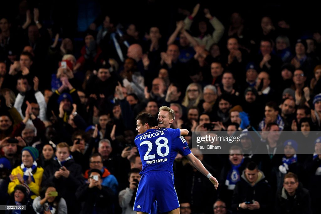 Andre Schuerrle of Chelsea celebrates with teammate Cesar Azpilicueta #28 of Chelsea after scoring his team's second goal during the UEFA Champions League group G match between Chelsea and Sporting Clube de Portugal at Stamford Bridge on December 10, 2014 in London, United Kingdom.