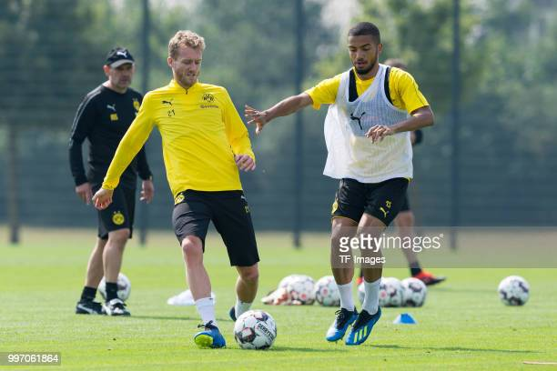 Andre Schuerrle of Dortmund and Jeremy Toljan of Dortmund battle for the ball during a training session at BVB training center on July 12 2018 in...