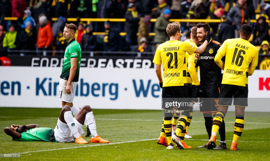 Andre Schuerrle of Dortmund celebrates with goalkeeper Roman Buerki of Dortmund after winning the Bundesliga match between Borussia Dortmund and Hannover 96 at Signal Iduna Park on March 18, 2018 in Dortmund, Germany.