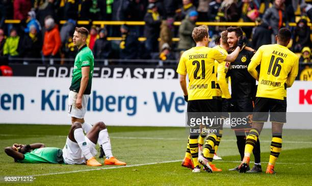 Andre Schuerrle of Dortmund celebrates with goalkeeper Roman Buerki of Dortmund after winning the Bundesliga match between Borussia Dortmund and...