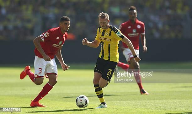 Andre Schuerrle of Dortmund runs with the ball during the Bundesliga match between Borussia Dortmund and 1 FSV Mainz 05 at Signal Iduna Park on...